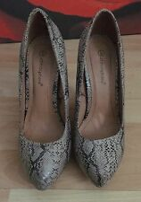 Snake patterned womens wedge heel shoes