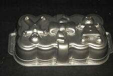 Nordic Ware Gingerbread People Loaf Cake Pan  Platinum Collection