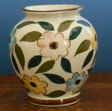 A Hand painted vase with blue yellow and pink flowers