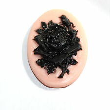 Resin cameo of  black rose on pink background 30 x 41mm