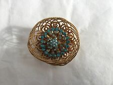 Vintage gold wire bird's nest brooch with turquoise rhinestones