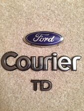 FORD COURIER REAR BADGE  (B8)