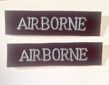British Army Airborne shoulder titles silver blue on maroon,a pair.