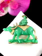 1960'S HATTIE CARNEGIE GOLD-TONE JADE LUCITE WATER BUFFALO ASIAN RIDER BROOCH