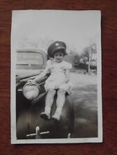 YOUNG GIRL SITTING ON CAR FENDER WEARING DAD'S ARMY HAT- VTG 1940's  PHOTO