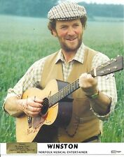 A 10 x 8 inch photo featuring and personally signed Winston the Singing Farmer.