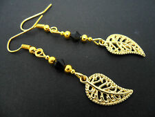 A PAIR OF  GOLD COLOUR  LEAF  & BLACK CRYSTAL  EARRINGS. NEW.