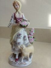 "10"" tall porcelain figurine of a girl/lady with a lamb & basket of flowers VGC."