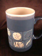 coffee mug cup blue raised sea shells beach summertime water ocean deck patio