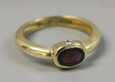 Classic 18K Yellow Gold Band Ring with .5c Oval Garnet & 2 Diamonds - Size 8.25