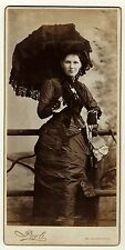 A FASHIONABLE WOMAN AND HER PARASOL IN ST. CATHARINES, ONTARIO, CANADA- CAB CARD
