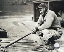 PITTSBURGH PIRATES HONUS WAGNER LOOKS OVER HIS BATS BEFORE GAME CLASSIC