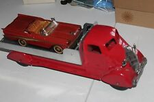 VINTAGE 1930's MARX PRESSED STEEL CAR CARRIER TRUCK w/ TIN B/O FORD RETRACTABLE