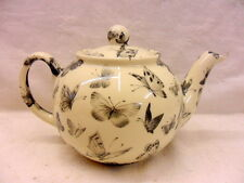 Black butterfly design 2 cup teapot by Heron Cross Pottery
