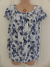 Next size 10 white blouse with navy and grey floral pattern, scoop neck with bow