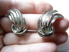 Vintage silver tone metal Flared curl clip on earrings signed Lisner