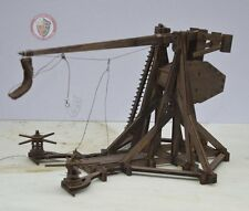 Wooden scale model of a trebuchet with side crank