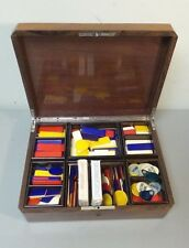 ANTIQUE WOODEN GAME BOX with COLORFUL CELLULOID COUNTERS, c. EARLY 1900s