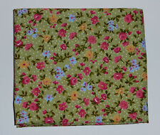 Fabric fat quarter with small pink flowers with green leaves on green with dots