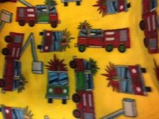 """Firefighter fire truck fleece fabric with a yellow background, 60"""" w, sold BTY"""