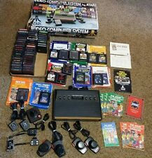 Atari 2600 With 61 Games Controllers Joystick Driving Paddle Catalogs Box L@@K!!
