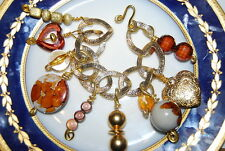 VINTAGE COUTURE GOLD TONED METAL BRACELET WITH VARIOUS ACRYLIC AND METAL CHARMS
