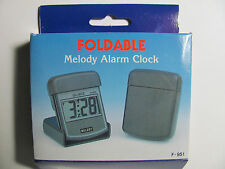 FOLDABLE LCD DIGITAL BLACK MELODY ALARM CLOCK FOR TRAVEL OR DESKTOP BRAND N
