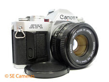 CANON AV-1 35MM SLR CAMERA + CANON FD 50MM F1.8 LENS & MANUAL EXCELLENT