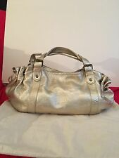 Authentic Gerard Darel 24 hours handbag in gold leather
