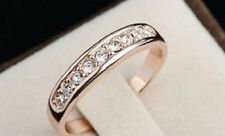 18K ROSE GOLD PLATED AUSTRIAN CRYSTAL ETERNITY RING. SIZE: O, Q