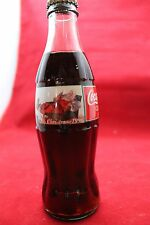 1996 Coca ColChristmas Bottle Santa in Chair