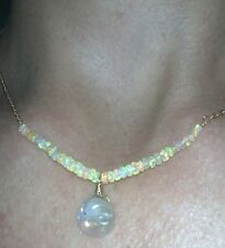 Super fire opals and rainbow moonstone carved man on moon face 14k necklace