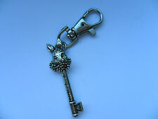 Unusual  Silver Plated Alice in Wonderland Rabbit and Key Keyring