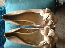 Beige leather bow front flat shoes with gold studs to bows. Size 4