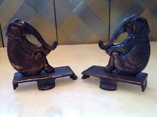 PAIR OF ANTIQUE CAST IRON BRONZE PATINA SEATED ELEPHANT DOORSTOP BOOKENDS
