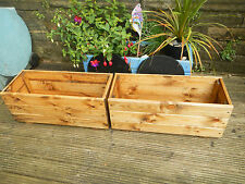pair of treated wooden garden planters plant pots