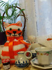 Hand knitted stripey cheeky retro cat tea cosy
