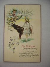 VINTAGE BIRTHDAY GREETINGS POSTCARD BOY IN TREE & GIRL W/ COW IN COUNTRY SCENE
