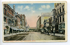 Worcester MA Mass Front Street looking East, signs, people, stores, 1917