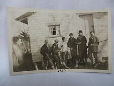 VINTAGE RPPC GROUP OF HUNTERS BY A HUNTING LODGE IN MAINE 1930 UNUSED