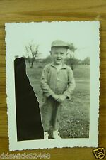 Little Boy wearing cap & coveralls outside posing for b/w photo EXPOSURE PROBLEM
