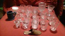 20 clear shot glasses, mini Boston tankard, small milkglass piece, brass slipper