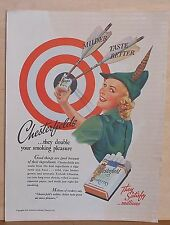 "1938 magazine ad for Chesterfields - ""Robin Hood"" attired woman at target"