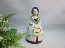 Vtg hand painted ceramic Japan figural bell. Lady in old fashion dress