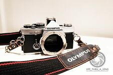 Olympus OM-2n MD 35mm SLR Film Camera Body Only with neck strap