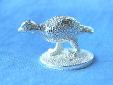 A HALLMARKED SOLID SILVER MODEL OF A GROUSE