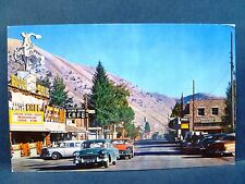 Postcard WY Jackson 1950's Downtown Street View Old Cars Silver Spur Cafe