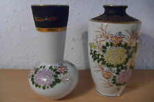 2 Oriental Bud Vases.Ceramic Hand Painted Floral Relief.bell Bottom.Tulip Style