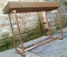 copper pipe and wood table