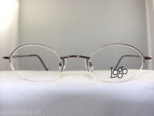 LOGO NY2613 SMALL SEMI RIMLESS EYEGLASS FRAME IN BROWN SIZE 45-20